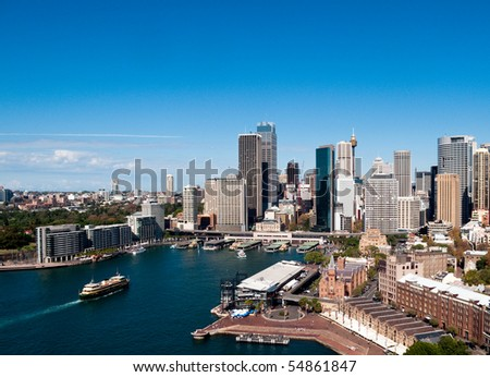 Circular Quay business district in Sydney Australia with a ferry entering the harbor
