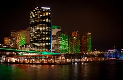 Circular Quay with reflections in the bay waters Sydney, New South Wales, Australia. Logos removed.