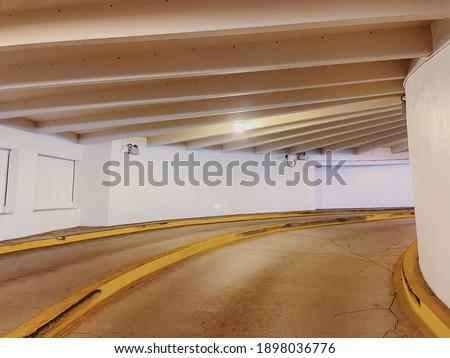 Circular ramp for cars between floors of a multi-storey car parking. Circular ramp entrance in multi-storey car parking Сток-фото ©