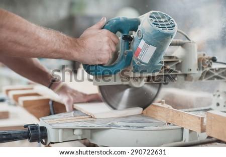 Circular Saw. Carpenter Using Circular Saw for wood #290722631