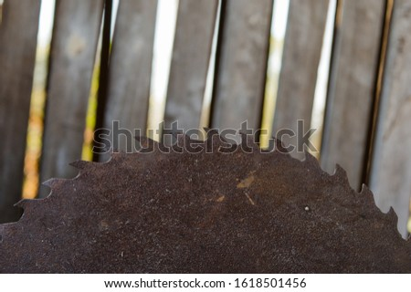 Circular saw. Circular saw blade for wood work. Sharp toothed disk. Metal toothed disc. Wood cutting tool used in carpentry