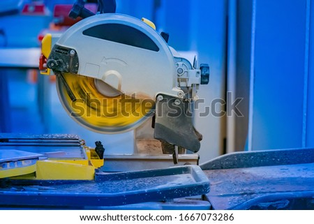 Circular Saw. Circular saw in working condition. Sawing stone slabs. Production equipped with a circular saw. Equipment for cutting stone and tile. Tile workshop. Construction. Stone cutting machine