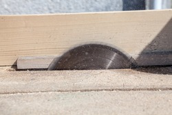 Circular saw cutting the wood. Close-up. Joiners (carpenters) workshop.