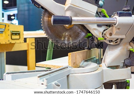 Circular saw for wood. Woodworking equipment. The sawing of wood. Circular saw in close-up. Machine for sawing wood and plywood. Carpentry equipment. Electric circular saw.