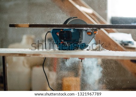 circular saw for working with wood with metal fixed on the table, a working tool for working in construction #1321967789