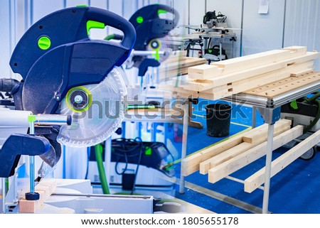 Circular saw next to wood beams. Stationary circular saw in a furniture workshop. Concept - furniture manufacturing workshop. Circular saw for working with wood. Sale of equipment for wood processing