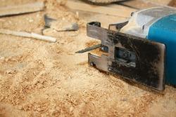 circular saw tool on wooden panel. closeup for design work
