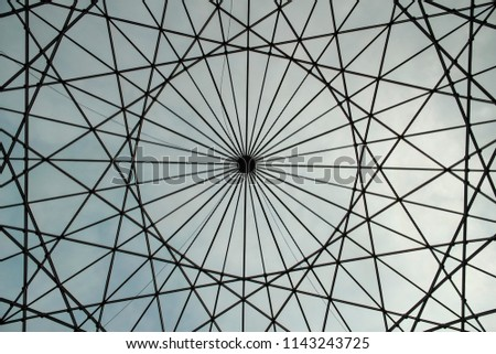 Circular shaped metallic structure with a sky background #1143243725