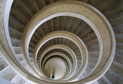 Circular stairs in Chinese temple in Singapore. Building of worship