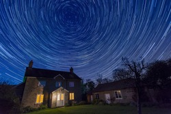 Circular star trails above an English country house, Herefordshire, UK