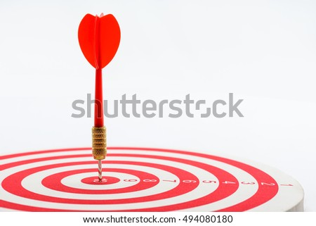 Circular target marked with numbers and red dart. An idea of targets i.e business, price, audience, market, group, practice, analysis, risk, range, rate, state, tracking, area, value, cost, site, etc.