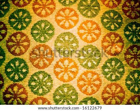 circular textile background,green brown carpet