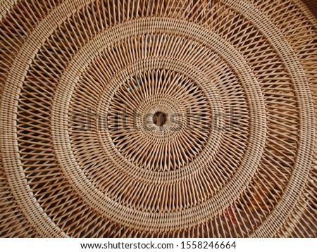 Circular weave rattan pattern Round Rattan Furniture Background Brown Texture Close-Up, Weave Rattan Texture And Background