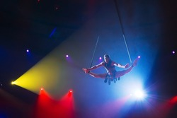 Circus actress acrobat performance. The acrobat perform acrobatic elements in the air