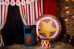 Circus backstage in retro style, drum on aa pedestal. Red stripped curtain background with various circus objects. Circus Theater stage. Old circus arena interior