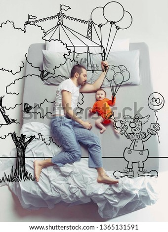 Circus brings bright emotions. Top view photo of young man and his child sleeping in a big white bed. Dreams concept. Painted dream about family weekend, entertainment, balloon, clown, walk. #1365131591