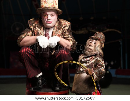 Circus clown with a monkey. Photo.