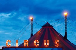 Circus. fragment of circus design, dome on blue sky background. Circus on wheels. Entertainment for children and adults. Luminous LED signboard, letters of word circus