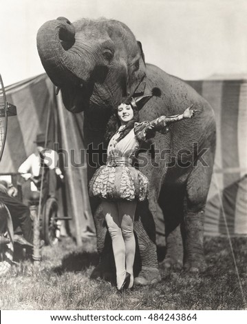 circus performer posing with...