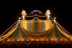 Circus tent at night with its colorful lights on