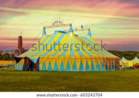 Circus tent under a warn sunset and chaotic sky without the name of the circus company which is cloned out and replaced by the metallic structure #603243704