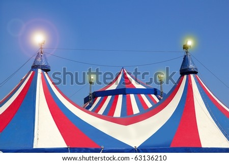 Circus tent under blue sky colorful stripes red white [Photo Illustration]