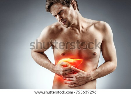 Cirrhosis of the liver. Photo of man holding his hand in area liver and grimacing in pain on grey background. Medical concept #755639296
