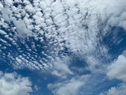 Cirrocumulus clouds are filled with beautiful streaks of clouds in the morning. Like small ripples a thin sheet of white ice crystals.no focus