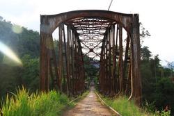 Cisondari, Bandung - Indonesia. old rusty railway iron bridge