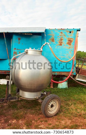 Cistern for milking parlor in pasture, Franche Comte, France. #730654873