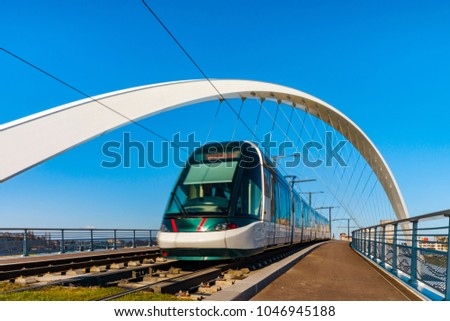 Citadelle Bridge across Bassin Vauban for trams and bicycles. Part of the new tram line Strasbourg - Kehl. France - Germany. #1046945188
