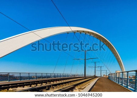Citadelle Bridge across Bassin Vauban for trams and bicycles. Part of the new tram line Strasbourg - Kehl. France - Germany. #1046945200