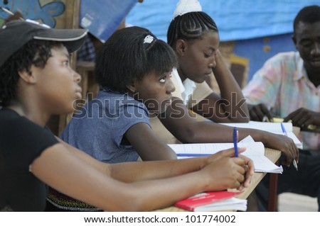 CITE SOLEIL- AUGUST 25:  Female students attending classes in a local community school in Cite Soleil- one of the poorest area in the Western Hemisphere on August 25