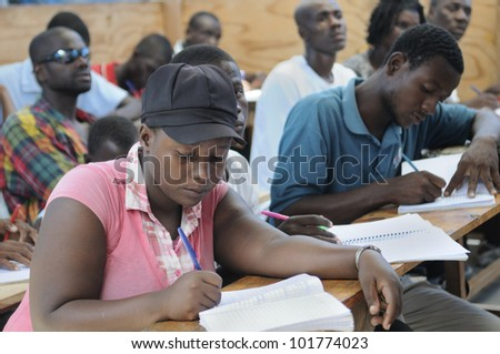 CITE SOLEIL- AUGUST 25:  Students doing their classwork in a local community school in Cite Soleil- one of the poorest area in the Western Hemisphere on August 25 2010 in Cite Soleil, Haiti.