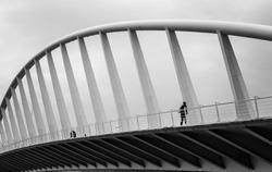 Citizen walking over L´exposicio Bridge