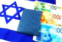 Citizenship and business in Israel concept. Passport Israeli, shekel Israeli (currency ILS ) and Israeli flag (passport booklet, translated from the Hebrew and Arabic :Ministry of Interior, ID)