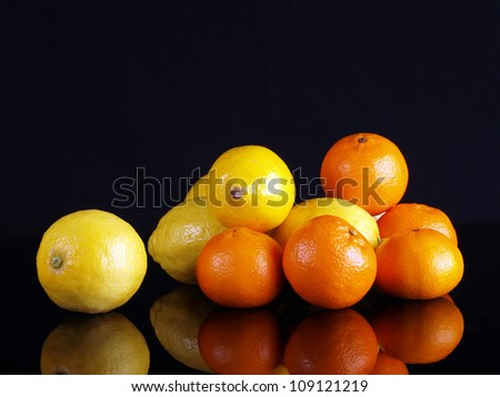 Citric fruits. Lemons and tangerines.