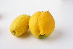 Citrons (Citrus medica) isolated against a white background
