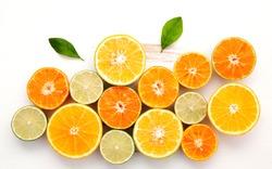 Citrus background. Assorted fresh citrus fruit. Lemon, orange lime,mandarin. Fresh and colorful concept. Top view