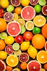 Citrus background. Fresh citrus fruits - Lemons, oranges, limes, grapefruits.