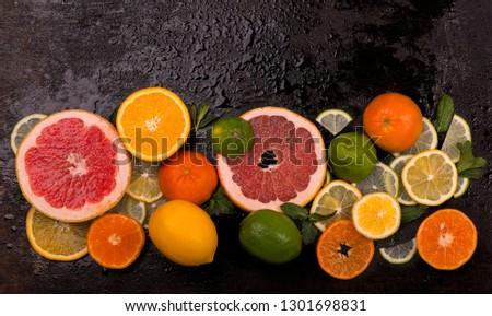Citrus background. Fresh citrus fruits - Lemons, oranges, limes, grapefruits On wooden background #1301698831