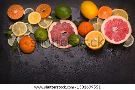 Citrus background. Fresh citrus fruits - Lemons, oranges, limes, grapefruits On wooden background #1301699551