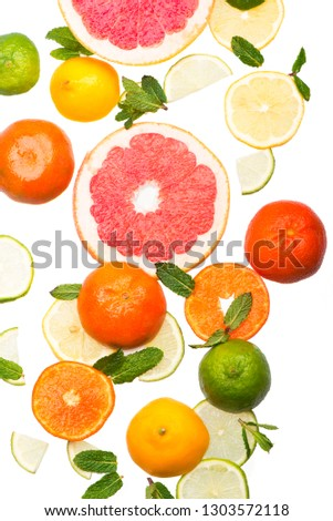 Citrus background. Fresh citrus fruits - Lemons, oranges, limes, grapefruits On wooden background #1303572118