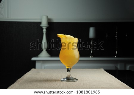 Citrus cocktail in a tall glass on the table