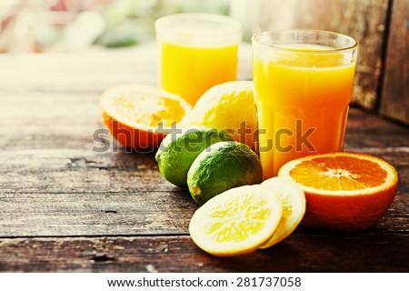 Citrus fruit and juice/ multy fruit juice / Selective focus