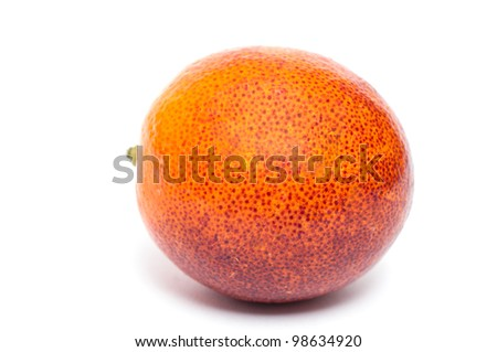 Citrus fruit blood orange in front of a white background
