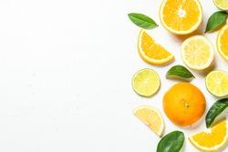 Citrus fruits at white background.