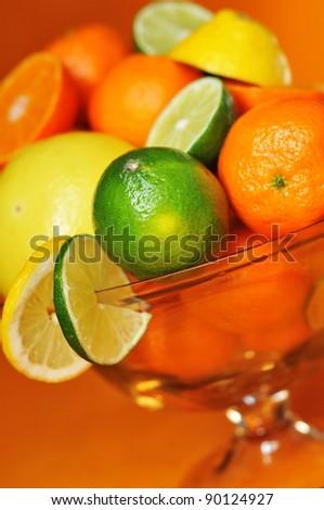 Citrus fruits in beautiful vase