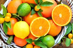 Citrus fruits in rustic background.Fresh oranges, lemon, mandarins, clementines, grapefruits, kumquats.