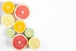 citrus fruits orange, grapefruit, lemon and lime on white horizontal background